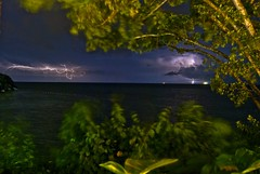 Lightning over the ocean in Jamaica (Dave DiCello) Tags: blue vacation storm beach water rain clouds nikon honeymoon tripod couples jamaica shutter tropical caribbean lightning sanssouci thunder ochorios d40 couplessanssouci jamaicanresort couplessansouci caribbeanresort d40x evad310 davedicello jamaicacouplessansouci hdrexposed