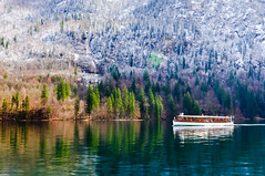Tourist Boat on Knigssee Lake (Sergiu Bacioiu) Tags: morning mountain lake snow alps color reflection green nature water germany landscape bayern bavaria berchtesgaden boat nationalpark colorful outdoor tourist alpine alpen deu knigsee knigssee touristboat nationalparkberchtesgaden berchtesgadennationalpark knigsseelake schnauamknigssee