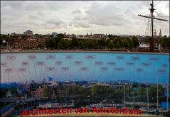 Idealism vs Realism (Canis Major) Tags: holland netherlands amsterdam skyline nemo picture landmarks nemocentre unrealbluesky realgreyskies