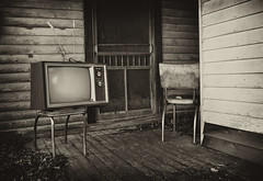 Never Again... (Greg Foster Photography) Tags: door wood old blackandwhite bw white house black abandoned home monochrome television georgia blackwhite tv chair chairs antique decay deck forgotten porch nostalgic weathered frontporch abandonment reclamation screendoor zenith oldtv