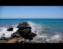 Rocks in the blue.. (amirosphere) Tags: blue sea art nature nice spain pentax outdoor bahia gran feliz dslr canaria k10d pentaxk10d smcpda1855mmf3556al justpentax pentaxart