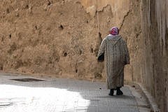 bound for home (mountainbogy) Tags: africa woman wall hijab morocco fes
