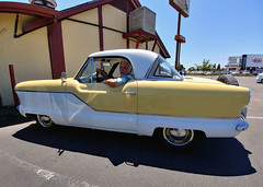 Ted: 1961 Nash Metropolitan (RZ68) Tags: ted 1961 metropolitan nash morris minor great britain english car automobile small classic yellow white chrome man driver lg g6 candid street shot parking lot cool dude vintage old 61 hudson driverandcar british