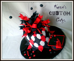 HS Graduation Cake (Kara's Custom Cakes) Tags: flowers red black diamonds graduation swirls fondant graduationcap loopybow wireaccents