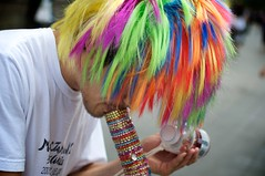 Bright Ideas (glasseyepictures) Tags: park street new york city nyc musician color colour art colors 35mm hair square lens prime rainbow nikon colorful long artist bright wind manhattan union pipe wide wig instrument entertainer colourful horn 14th performer d90