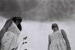 Storm gazing (Adele M. Reed) Tags: girls sky blackandwhite film clouds contrast 35mm shoot grain dresses ghosts commission redemption forgiveness canoneos500n illford400