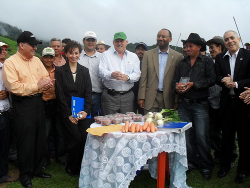 Producers in the mountains of Jutiapa show off their products including strawberries, carrots and onions. Pictured in the front row (L-R) are: Miguel Angel Bonilla, FUNDER's director; Ana Gomez, agricultural specialist; Victor Villalobos, Inter-American Institute for Cooperation on Agriculture; FAS Administrator Brewer; Cesar Almendares, a local producer and Bob Hoff, agricultural counselor.