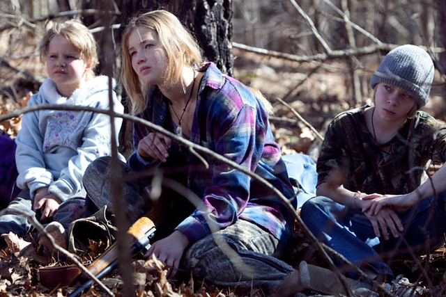 Ree (Jennifer Lawrence) and her younger siblings shoot themselves some squirrel in 'Winter's Bone'.