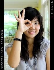 Okay Ka /   (AmpamukA) Tags: portrait cute girl garden thailand pretty hand bangkok secret thai ok act ka bkk okay muk     canon50d      totallythailand