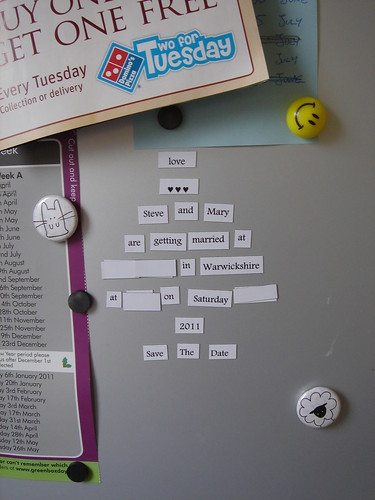 Save the Date magnets in place on our fridge