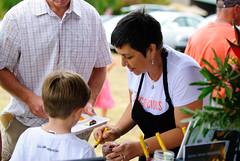 Dania Katz serving a customer at Slow Food Maui's Taste Education event, at Ali'i Kula Lavender.