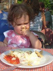 Milly Dotsey eating food at the Quinns'