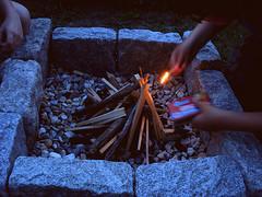 fire starter (On Bradstreet) Tags: fire firepit summerevenings unschooling familyrituals outdoorskills keepingitsimple eveningsathome backyardfirepit simplefirepit kidsbuildingfire