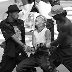 The Beat Goes On (CANEOS7E (Eddie)) Tags: nyc newyorkcity bw canon iso100 dancers candid streetphotography l bryantpark 135mm urbanlife f20 streetdancers vidaurbana urbannewyork 40d fotourbana callejando