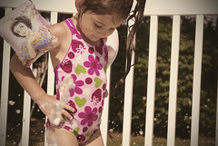 {Rhianna 365} day 339 - beat the summer heat (citygirlny10305) Tags: flowers wet pool girl outdoors toddler pentax strawberries naturallight railing splash bathingsuit pigtail cs4 swimmies 365project