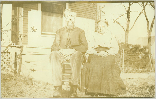 Man and Woman posing in front yard