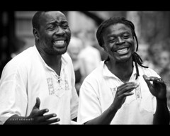 Take Two (Carl Stovell) Tags: street two white black smile canon happy pair singers 135mm f32 1800sec 450d