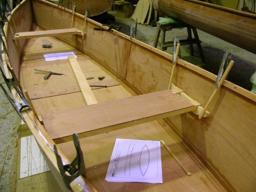 Fitting seats to the plywood canoe.  See slideshow for details.
