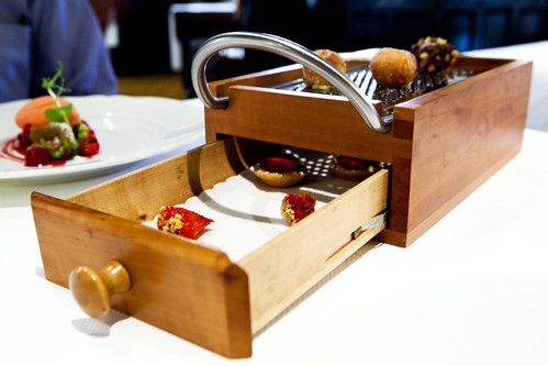 A large grater box holding petit fours