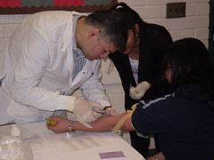 Volunteer Doctor Assists South Asian Community Member