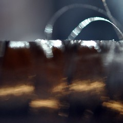 chocolate orchestra (SteffenTuck) Tags: light shadow blur macro silver bokeh interior sparkle softfocus athome inside sheen reel metallicthread steffentuck