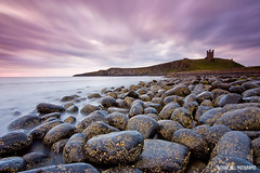Dunstanburgh (Azzmataz) Tags: castle clouds sunrise explore northumberland dunstanburgh explored anthonyhallphotographic shinyfrictionlessrocksofdeath