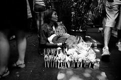Making a sale (tontygammy) Tags: street people blackandwhite bw monochrome asian thailand sale handmade walk bangkok candid grain documentary oldwoman grainy sell wicker chatuchakweekendmarket wickerwork grd3 grdiii ricohgrdigitaliii southeastasia