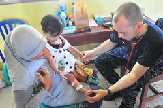 Examining an Infant (America's Navy) Tags: infant military medical doctor militar nio usnavy unitedstatesnavy asistenciamdica pacificpartnership2010
