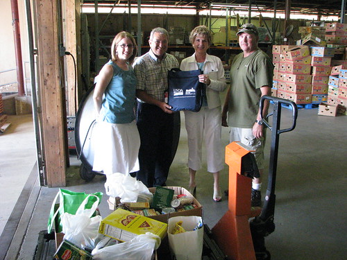 USDA Rural Development State Director Colleen Callahan presents food (on cart, foreground) donated by the state office in Champaign, Ill., to staff at Eastern Illinois Foodbank:  (from left) Cheryl Precious, director of marketing and development; Jim Hires, executive director; State Director  Callahan  and Matt Pieper, transportation supervisor.