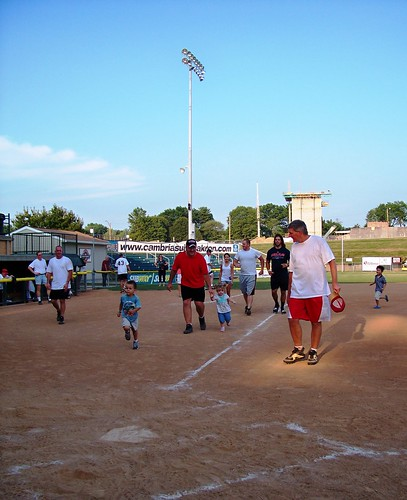 Dave and Lucy run to home plate at Firestone Stadium