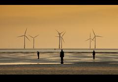 Odd man out, Another place, Crosby beach, Explored! (Ianmoran1970) Tags: sunset orange men beach water statues windmills explore gormley antonygormley merseyside windturbines anotherplace ironmen explored ianmoran