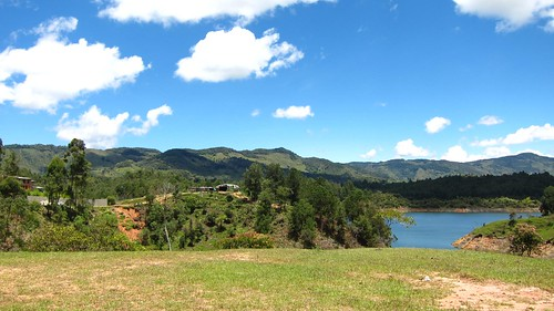 Rolling hills surrounded by lakes create picturesque views.