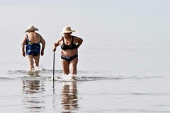 In opposite directions - 20100817_0043ed2 (greekadman) Tags: old sea people swim fun greek weird women chat mud grandmother greece granny nafplion oldwomen canon70200f28 canon30d neakios