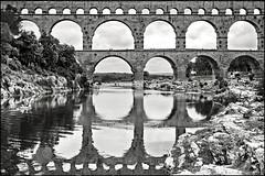 pont du gard (heavenuphere) Tags: world bridge bw france heritage stone site unesco aqueduct pontdugard 1022mm gi gard languedocroussillon verspontdugard