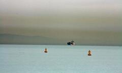 The Bay of Tunis: haze, buoys and a ship (10b travelling) Tags: africa ctb bay boat ship northafrica tunisia tunis revolution ten maghreb afrika buoys carthage carsten buoy tunisie afrique brink 10b tunesie buoyant cmtb tenbrink arabspring republiquetunisienne altunisiyya
