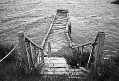 (patrickjoust) Tags: ocean leica wood sea bw white canada black abandoned blancoynegro film home broken nova analog rural america 35mm ed pier dangerous nikon focus with mechanical kodak scanner ns trix country north goggles patrick overcast rangefinder 11 1600 falling v 400 cape manual scotia m3 joust 35 range finder developed premium breton wetzlar apart develop xtol f35 summaron blancetnoir leitz cheticamp arista rebranded schwarzundweiss autaut leicasummaron35mmf35 rebadged patrickjoust