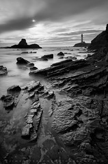 Battered Coast and the Pigeon Point Lighthouse - San Mateo, California (Jim Patterson Photography) Tags: pictures ocean california longexposure travel sunset sea portrait sky blackandwhite usa lighthouse seascape storm beach nature water monochrome vertical clouds landscape coast marine rocks natural pacific photos tripod salt shoreline rocky wideangle stormy highway1 coastal filter shore historical coastline gitzo sanmateo pigeonpoint pescadero reallyrightstuff remoterelease nikkor1224mm neutraldensity singhray statehistoricalpark bwnd110 nikond300 markinsm20ballhead jimpattersonphotography jimpattersonphotographycom darylbensonreversefilter seatosummitworkshops seatosummitworkshopscom
