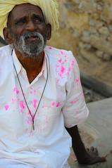 Man in Nimaj (Irene Stylianou) Tags: pink portrait india man colour yellow festival nikon paint candid indian oldman fuschia celebrations portraiture turban tradition nikkor dslr holi nikondigital vr rajasthan d300 candidportrait holifestival nikoncamera seniorman 18200mm indianfestival nimaj vr2 nikkor18200mm indiantradition portraiturephotography nikond300 flickraward irenestylianou nikkorzoomlens18200mmf3556