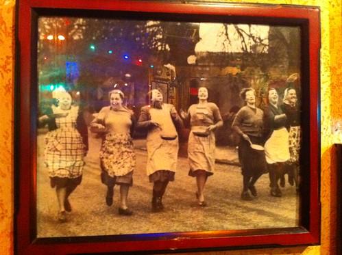 Women flipping omelets in the street