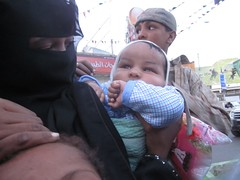 Red light, Sanaa, Yemen (Kate B Dixon) Tags: baby children veil muslim middleeast hijab yemen niqab ramadan iftar