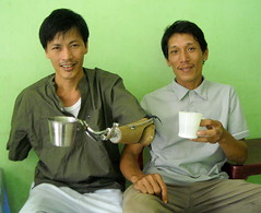 Coffee Time (valockett) Tags: cup arm vietnam danang prosthesis amputee disability adaptive