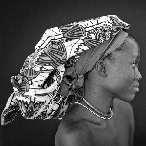 Mukubal Woman With Ompota Headdress, Angola by Eric Lafforgue