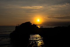 dying sun on tanah lot (alain01789) Tags: sky landscape sea water sunset reflection nature sun light ocean temple bali silhouetteevening seascape shadows dawn seashore dusk backlit tanahlot paysage soleil nuages ciel crepuscule ombres lumieres velvia