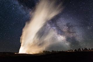Old Faithful and Milky Way crisscross on a clear summer night