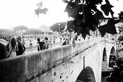 Over Tiber (lorenzoviolone) Tags: bw black white bridge candid finepix fuji x100s fujifilm ilford pan f plus monochrome people rni films shine leaf leaves mirrorless movie set strangers streetphoto streetphotobw streetphotography tiber island walk:rome=june292017 blackwhite blackandwhite fujix100s fujifilmx100s ilfordpanfplus rnifilms movieset tiberisland roma lazio italy