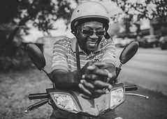 remembering (vujade762) Tags: street photography black white bike man helmet yesteryear