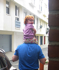 Speck on Daddy's shoulders, looking back over her shoulder at our doorway