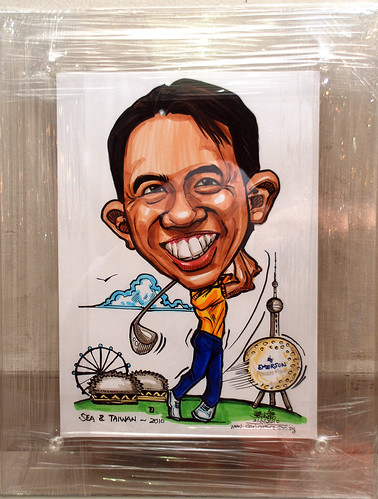 golfer caricatrure for Emerson Process Management in clear acrylic frame