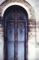 Tomb Doors (akki14) Tags: film cemetery montmartre expired finetta88 kodakkodacolor