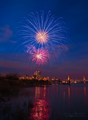 Canada Day Celebration  Fireworks in New Westminster (janusz l) Tags: longexposure bridge night river geotagged fireworks bridges celebration fraser canadaday skytrain newwestminster queensborough pattullo janusz leszczynski theunforgettablepictures july1st2010 geo:lat=49192881 geo:lon=122923387 010734
